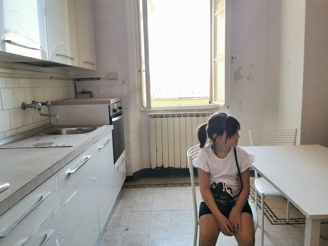 The writer's daughter, Mariù, on an early visit to the apartment.
