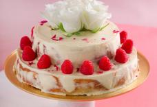 RASPBERRY AND DARK CHOCOLATE CAKE WITH HONEY CREAM CHEESE ICING AND ROSES