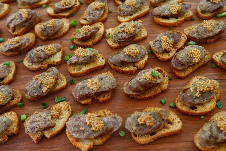 Brat Slice on a Crostini with Brat Caviar