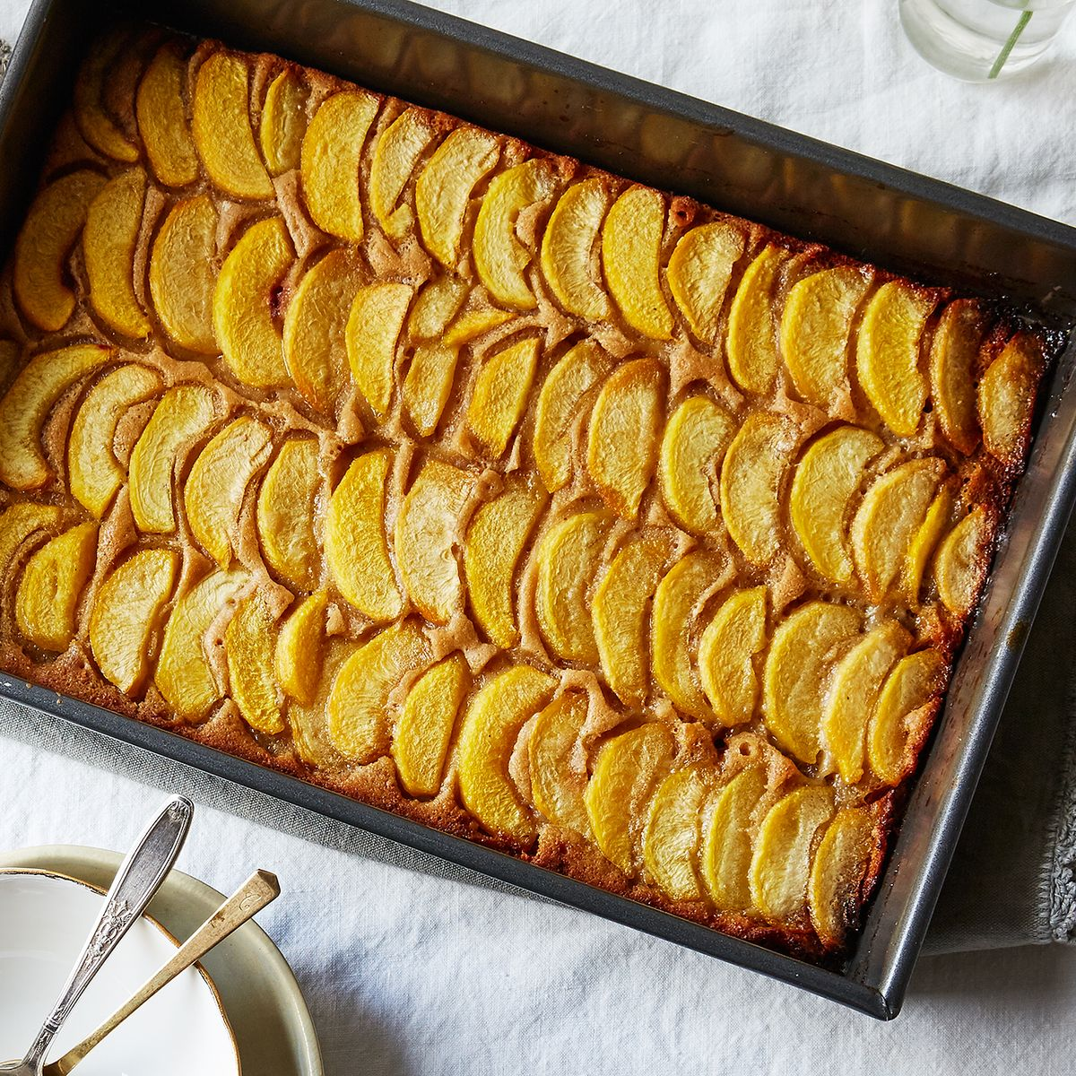 A Peach Cobbler That S Maybe Cake And Definitely Bakes In A Pool Of