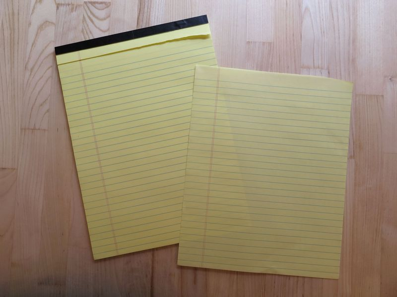 To remove a sheet from the pad, simply grasp it with three fingers and pull one way or another with brute force.