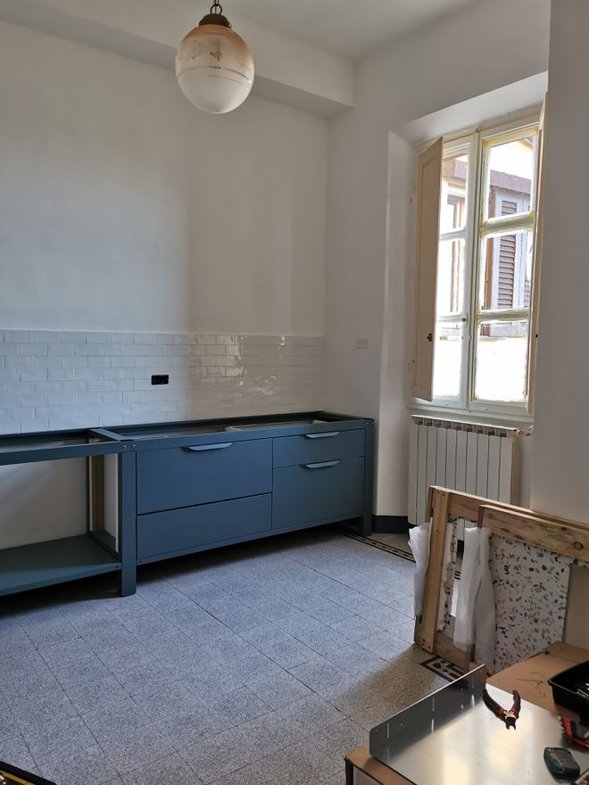 Industrial-style work benches, courtesy Very Simple Kitchen