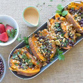 Stuffed Sweet Potatoes with Peanut Sauce