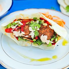 Delicious Falafel with fresh veggies and yogurt