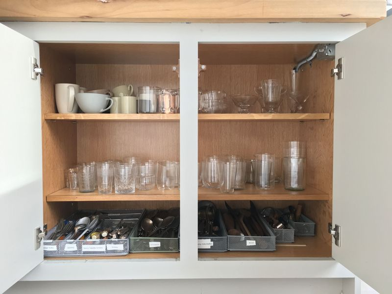 The Glass & Flatware Cabinet, with enough breathing room to actually reach in and grab what you need safely.