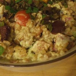 Farro with olives, tomatoes, herbs and chive yogurt dressing.