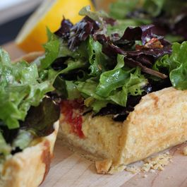 Parmesan tart with Caesar salad topping