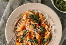 Creamy tomato penne with pesto and parmesan