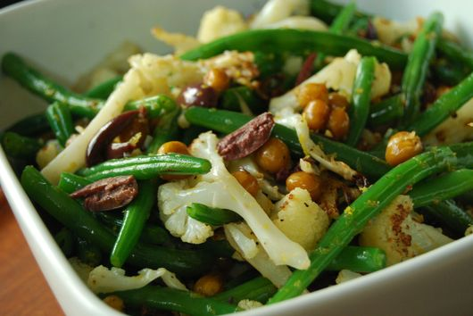 Roasted garbanzos and cauliflower with green beans, lemon and kalamata olives