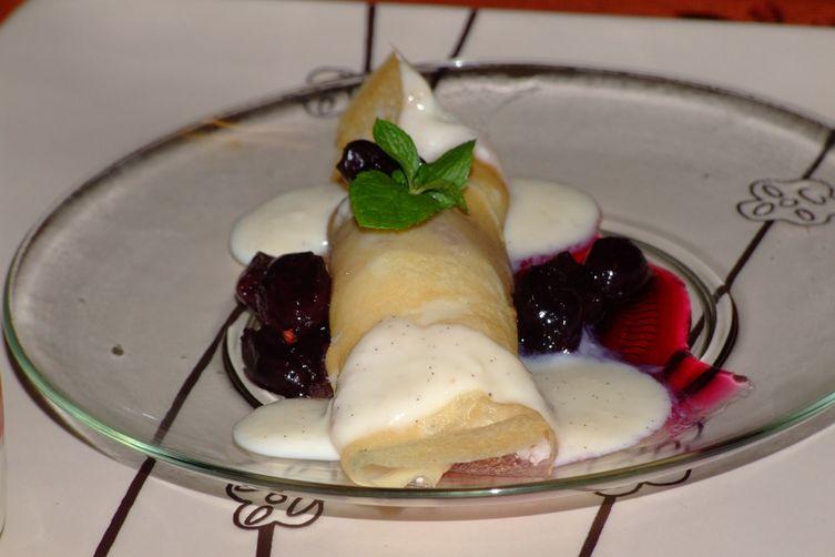 Motta  Khozhalappam( a crepe Stuffed with freshly grated coconut, golden raisons