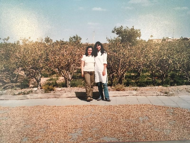 Pardis's youngest sister and her cousin at a pistachio farm in Iran in 2004. Photo courtesy Pardis Stitt