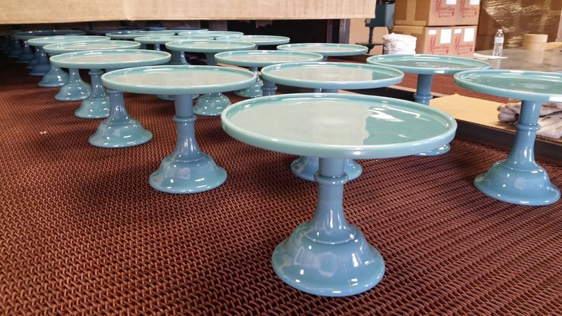 The blue looks lighter in bright lights and more saturated in shadows (these are the first of the new cake stands in production!).