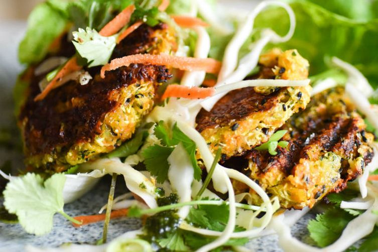 GINGER, BLACK SESAME & HALLOUMI BURGERS WITH SPICED TAHINI SLAW