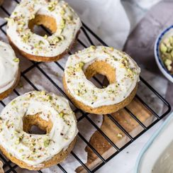 Carrot cake baked donuts with cream cheese and pistachio frosting