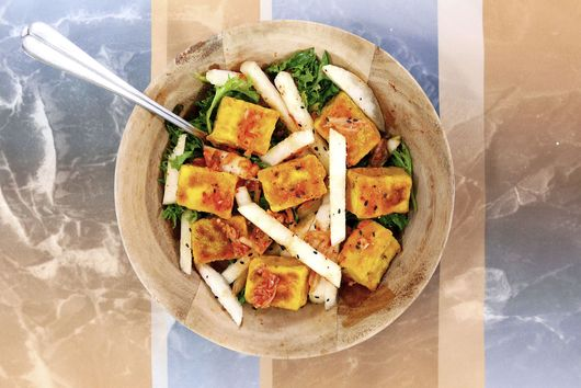 Turmeric coated Tofu and Asian pear salad with Kimchi dressing
