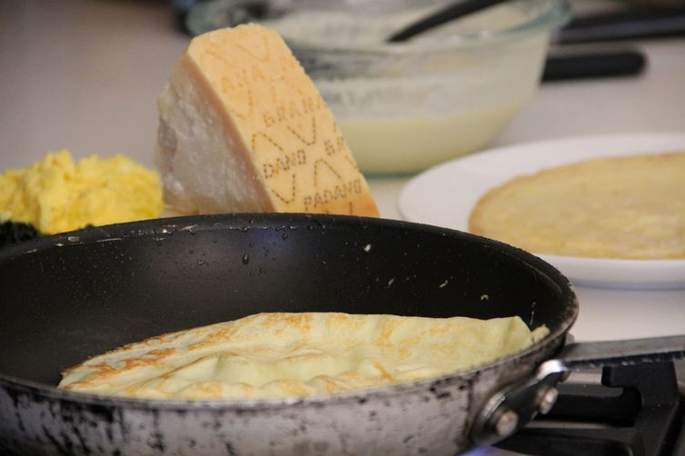 Grana Padano Crusted Crepes with Soft Scrambled Eggs, Kale and Caramelized Onion