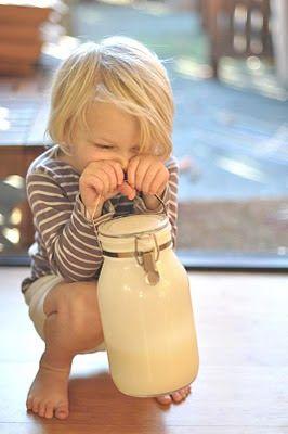 Dash hiding behind a bottle of cream