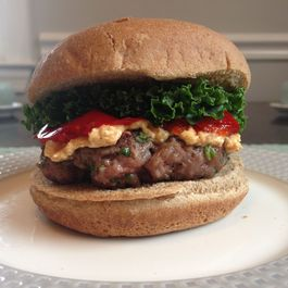 Lamb Burgers with Double-Paprika Feta Spread, Cherry Peppers, and Kale