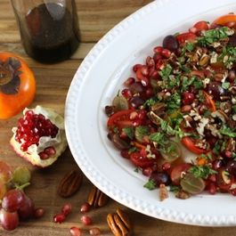 Persimmon, grape, pomegranate & burrata salad