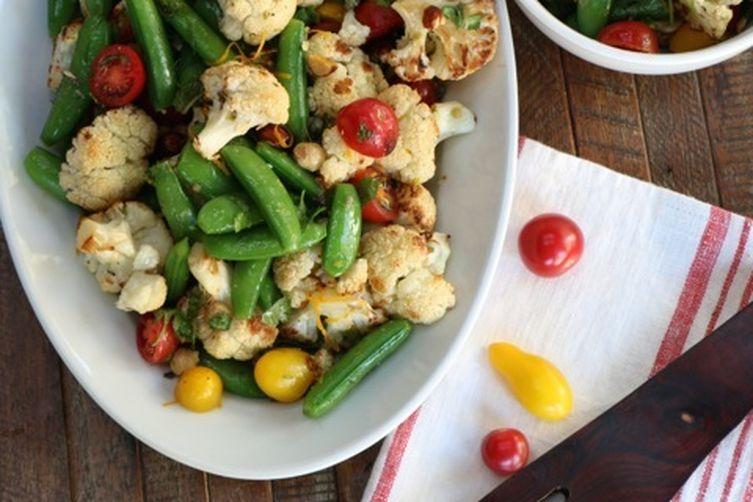 Cauliflower, snap peas and tomato salad