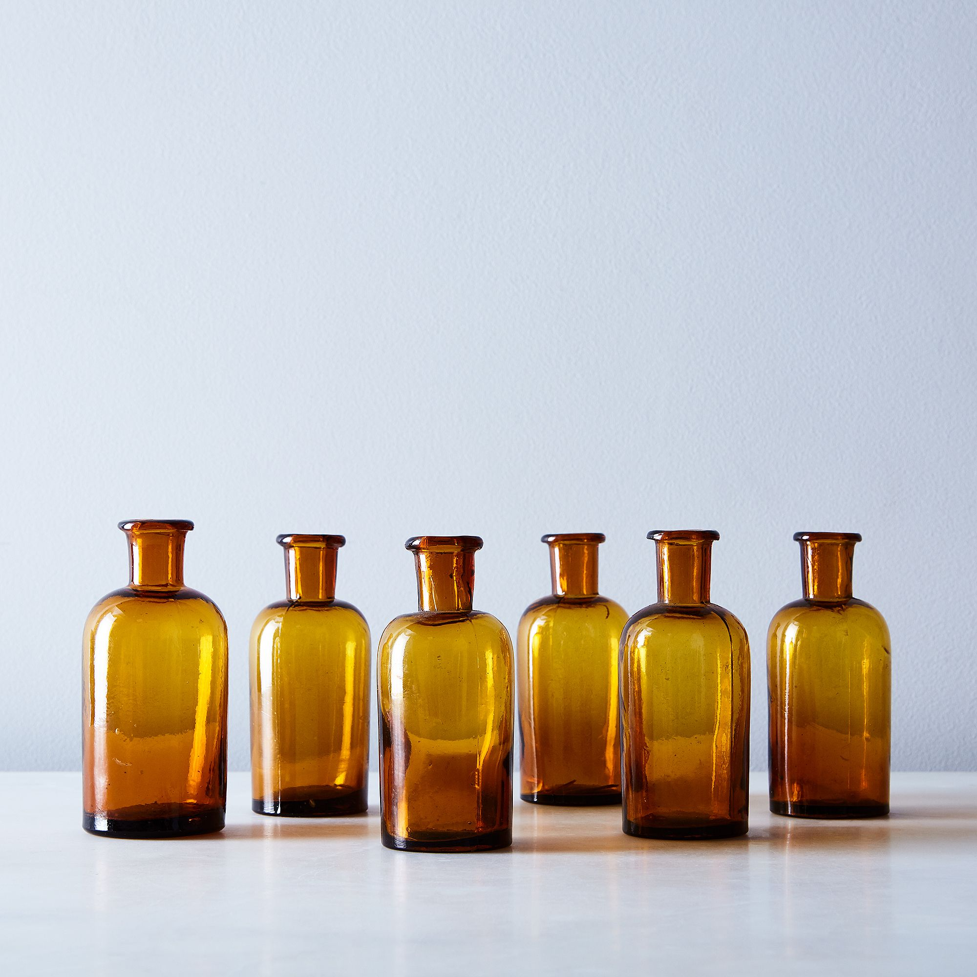 Eb4bb20d 9229 4a72 8712 da1632836016  2017 0609 food52 vintage shop vintage small amber apothecary jars set of 6 silo rocky luten 012