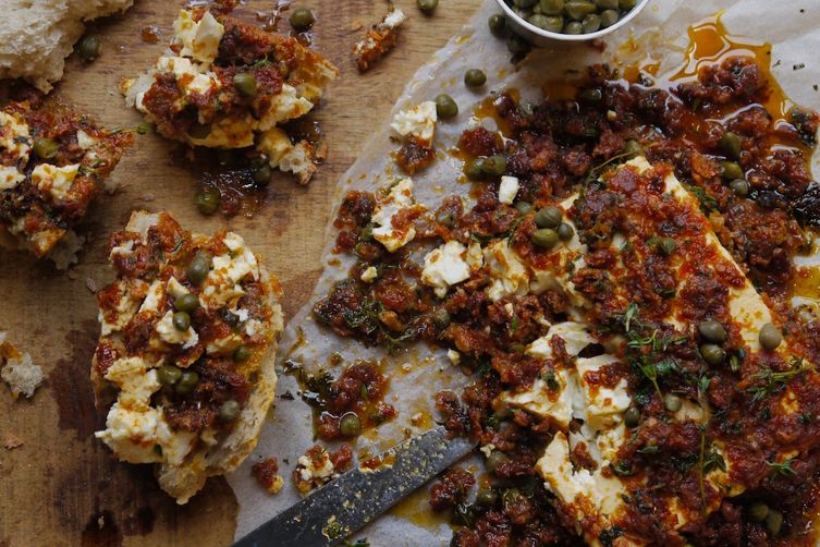 Baked feta cheese with sun dried tomato and capers