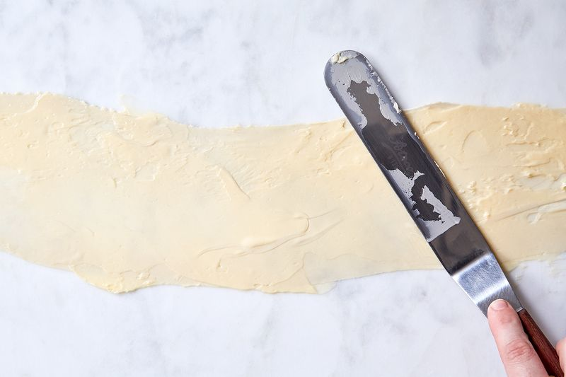 Spread soft butter with an offset spatula.