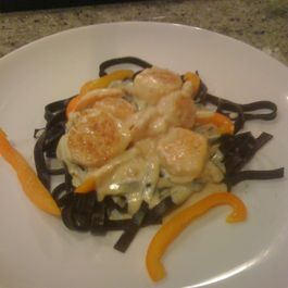 Shrimp and Scallops in Saffron Cream with Black Pasta