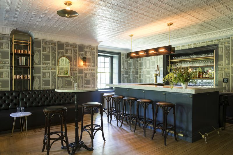 The front bar, with wallpaper from Cole and Son.