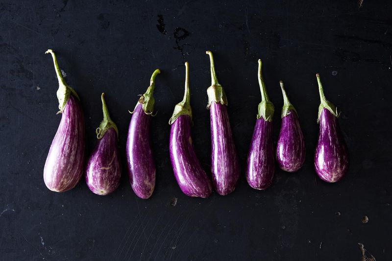 "On September: ""Out in the Greenmarket people circled patiently, holding cartons of prune plums, ears of the last silken corn, long, thin-skinned lavender eggplants."""