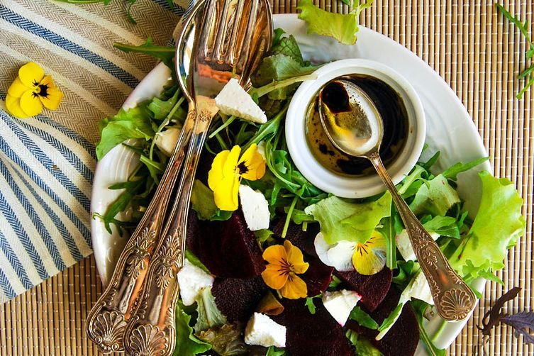 Flowers and beetroot  salad with soft goat cheese