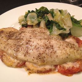 02d0ac7e 4958 4871 b491 087aa3b58b36  catfish with tomatoes and horseradish on a plate with escarole from feb 3 2015