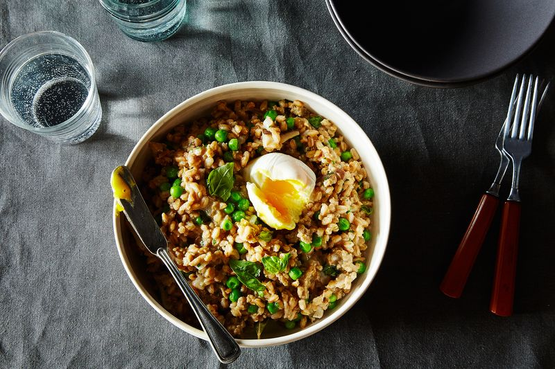 Farro Risotto with Sausage, Mushroom, Peas, and a Poached Egg