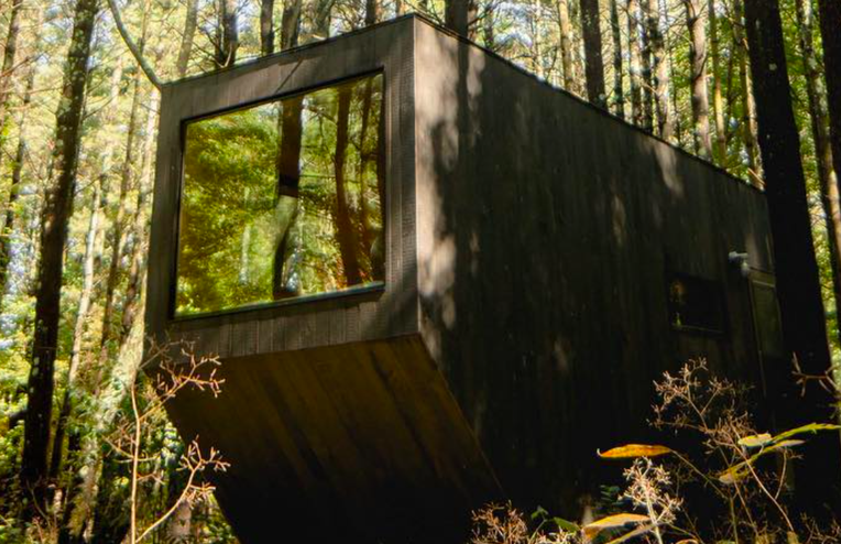 12 Tiny Cabins That Make Us Want to Pack Up a Tiny Suitcase & Move