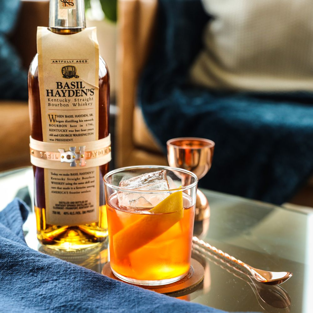 Smooth, palate-pleasing Basil Hayden's bourbon, plus aromatized wine and a lightly bitter aperitif, make a highly sippable cocktail combo for the holidays.
