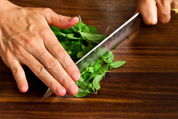 Chopping the basil