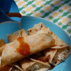 Patishapta- Indian crepe with cardamom coconut filling, drizzled with date syrup