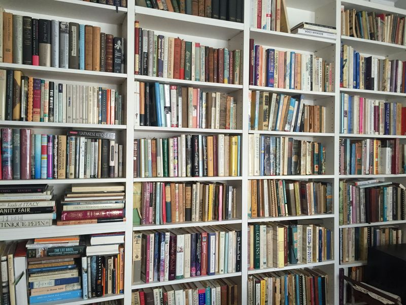 Just one wall of Judith's massive cookbook collection. Jealous?