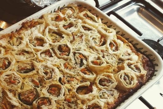 Creme fraiche quiche with zucchini and filo pastry rolls