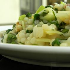 Couscous risotto with spring greens