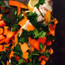 branzino with lemon, oregano, carrots, chard, and olives