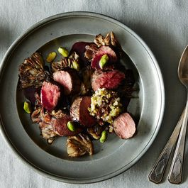 Roasted Lamb Medallions with Maitake Mushrooms, Pistachios, and Blackberry