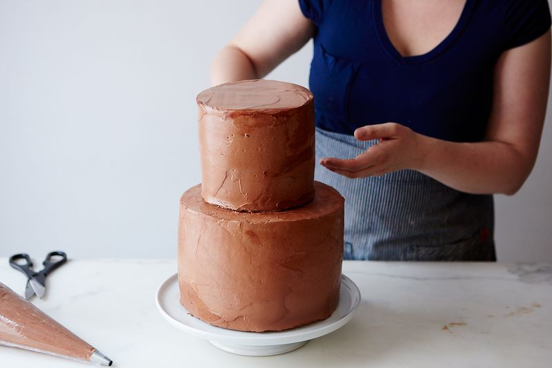 This cake is on the smaller side—just 2 tiers: one 6-layer, 9-inch cake, and one 6-layer, 6-inch cake—but will still feed about 50 people!