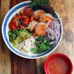 Vermicelli Noodle Salad with Charred Tomatoes, Romaine Lettuce, and Shrimp.