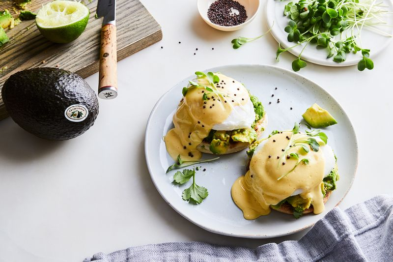 Smashed California Avocados steal the show in everyone's favorite brunch dish.