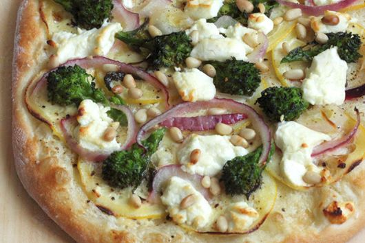 chèvre and rapini pizza with red onion, lemon, and pine nuts
