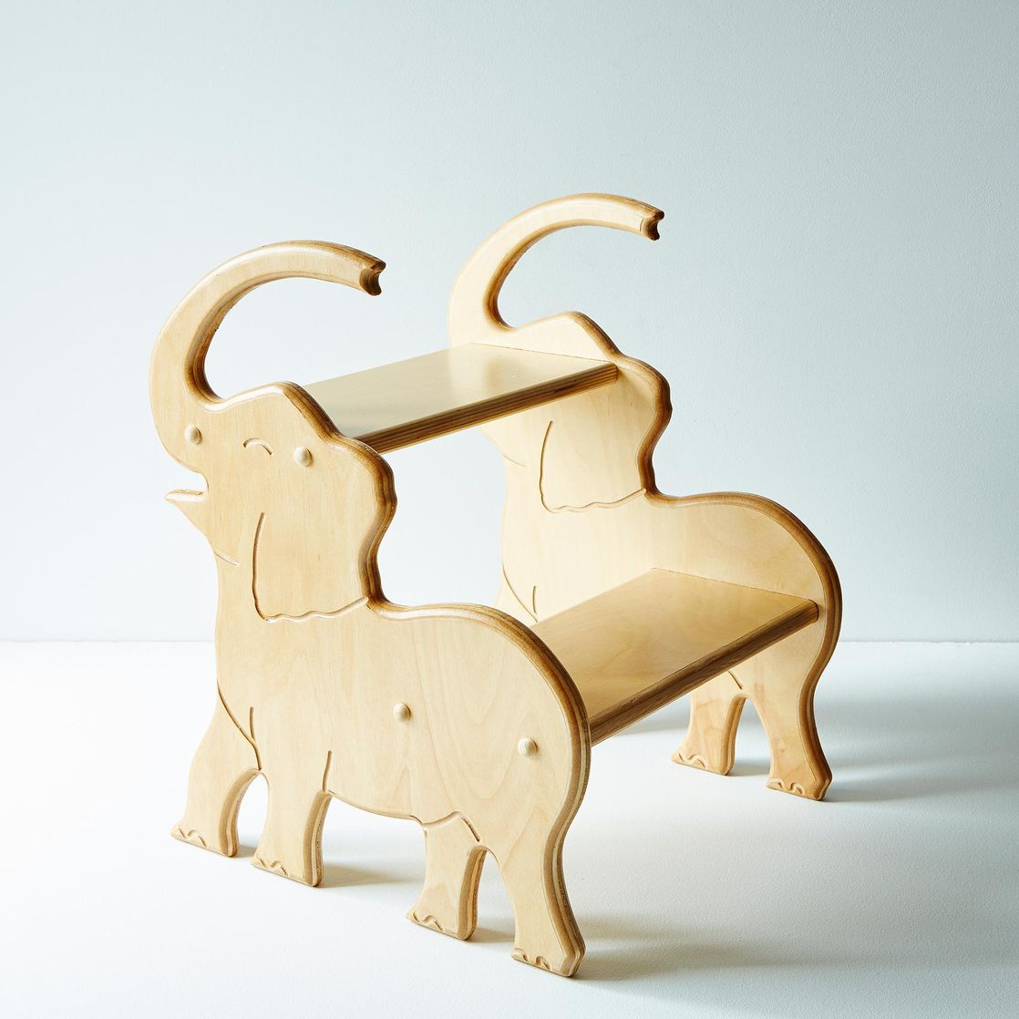 handcrafted elephant stool on food - handcrafted elephant stool