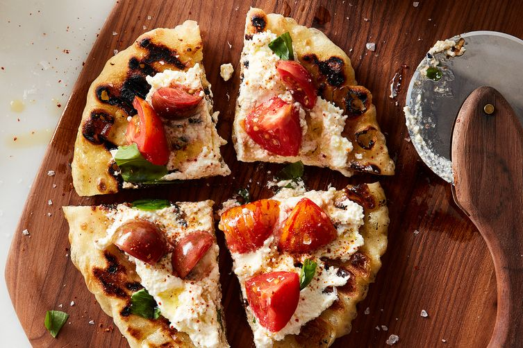 grilled pizza with marinated tomatoes and ricotta