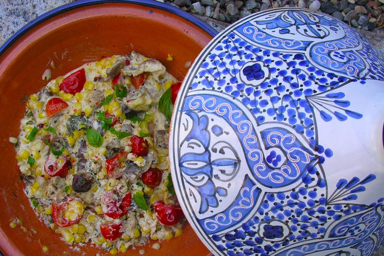 Creamy corn, mushroom and cherry tomatoes cooked in a tagine