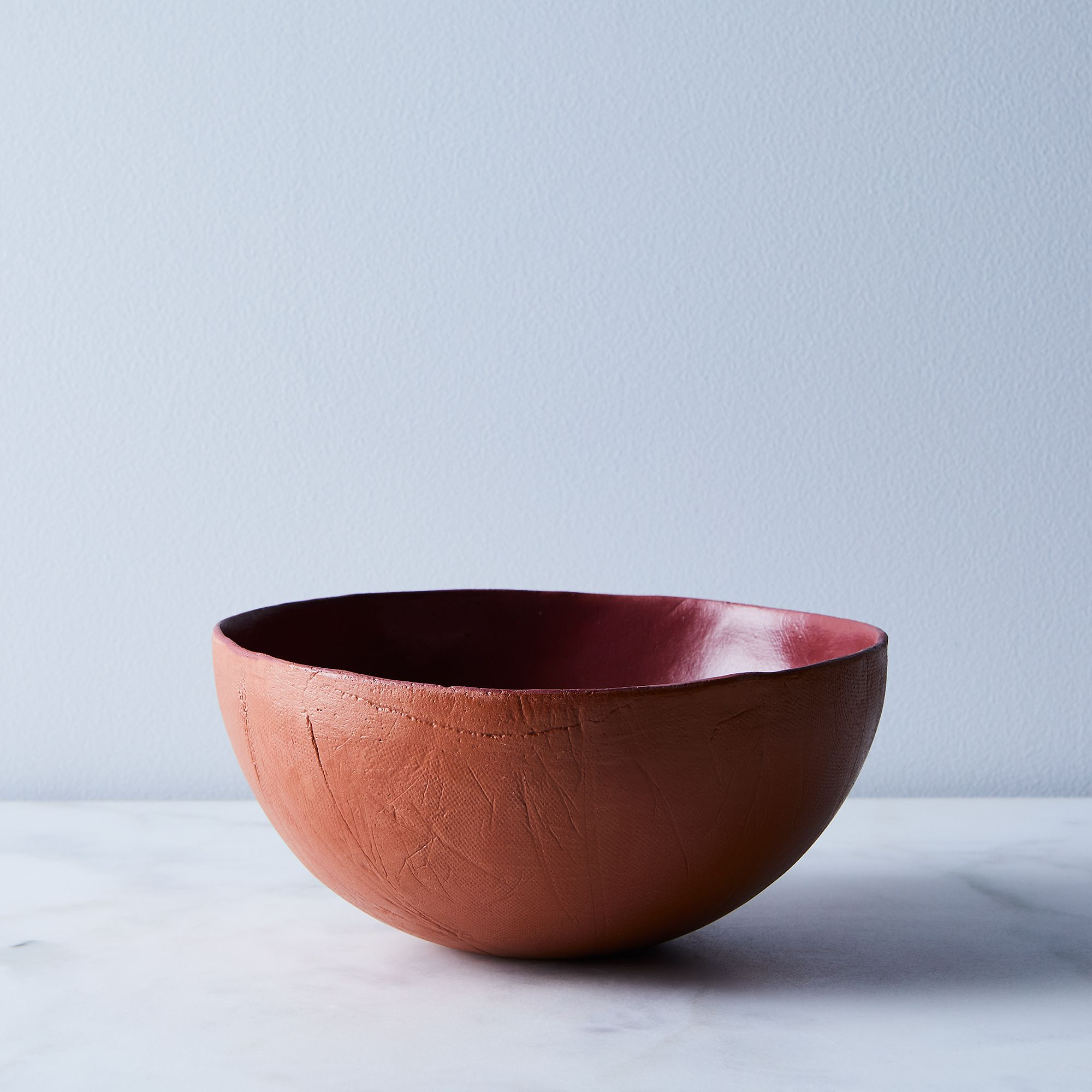 F2ce29f4 313e 421a bf4b 6771b3f652e7  2017 0929 sin food52 featherweight dinnerware deep bowl terracotta silo ty mecham 004